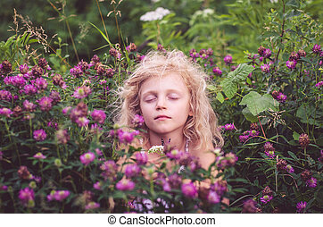 child in floral meadow