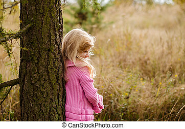 child in forest alone
