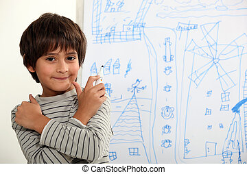 Child in front of blackboard drawings