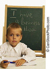 child in front of chalkboard/busines