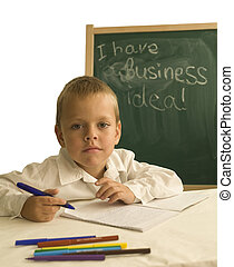 child in front of chalkboard/business