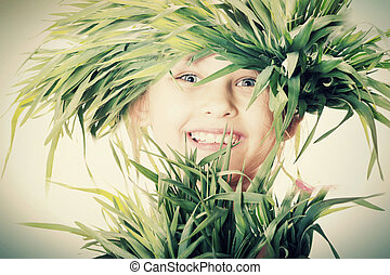 child in grass, smiling