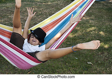 child in hammock smiling joy