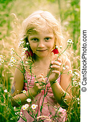 child in meadow