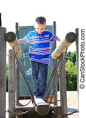 child in playground, kid in action playing