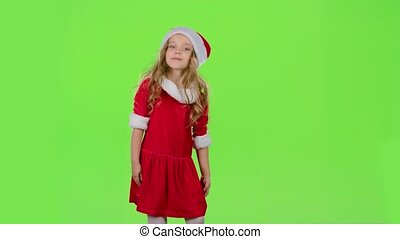 Child in red New Year costumes are dancing. Green screen. Slow motion