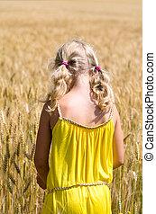 child in rye field