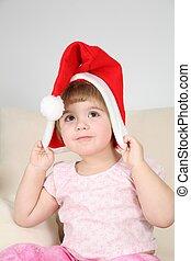 child in santa claus hat