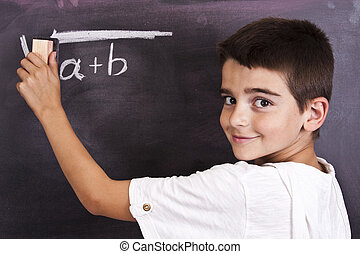 school - child in school blackboard with mathematical...