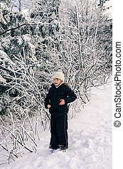 child in snowy forest