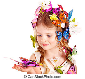 Little girl in spring hairstyle and butterfly. Isolated.