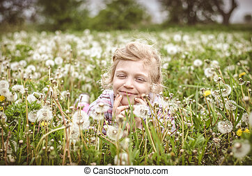 child in spring meadow