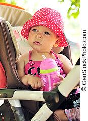 child in stroller