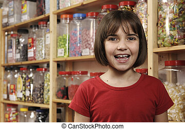 child in sweet shop