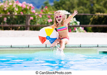Child in swimming pool on summer vacation