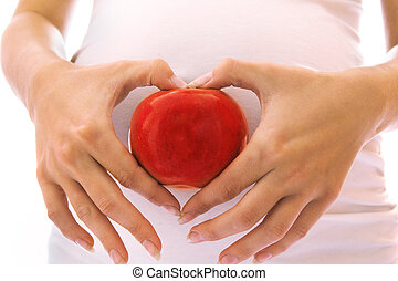 child in the belly of a pregnant with apple