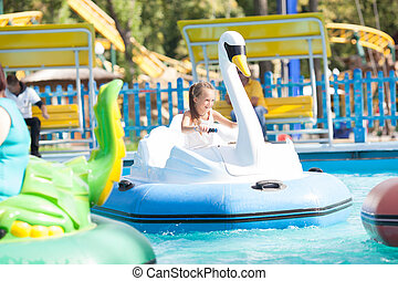 Child in the boat - swan rides in the park