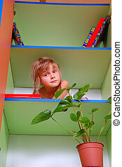 child in the bookcase