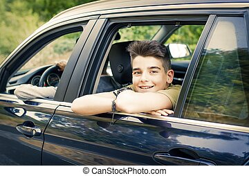 child in the car window