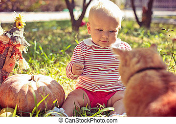 child in the garden with a cat