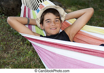 child in the hammock holiday
