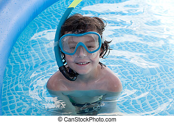 Child in the pool on holiday learning to swim
