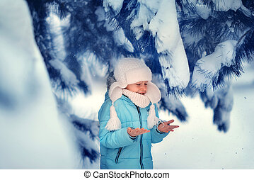 child in the winter forest