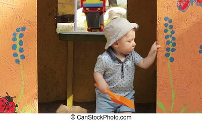 Child in toy house