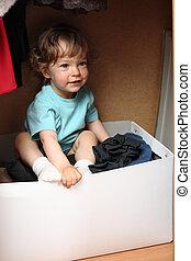 Child in wardrobe