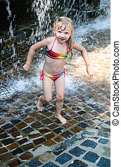 child in water aquatic park