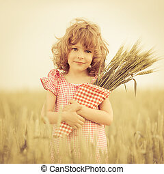 Child in wheat field