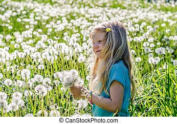 child in white dandelion meadow