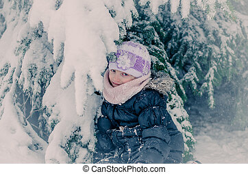 child in winter forest