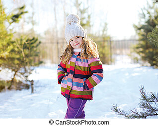 Child in winter sunny day