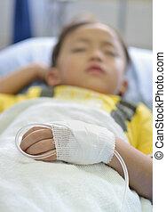 Child intravenous fluid - intravenous fluid line at left arm...