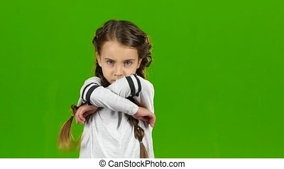 Child is angry, she is very nervous. Green screen