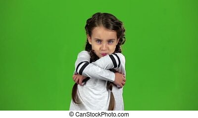Child is angry, she is very nervous. Green screen. Slow motion