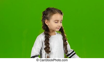 Child is dancing. Green screen