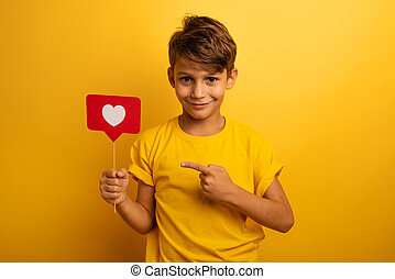 Child is happy because receives hearts on social network