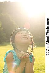 Child is making wish