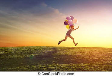 child is playing with balloons - Happy little child is...