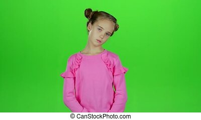 Child is sad in an empty room. Green screen. Slow motion