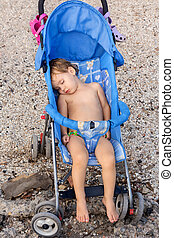 Child is sleeping in the stroller