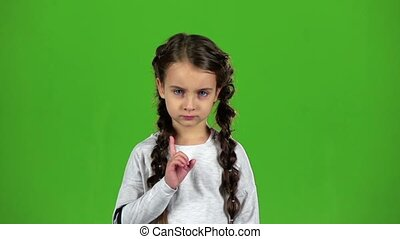 Child is unhappy. Green screen. Slow motion