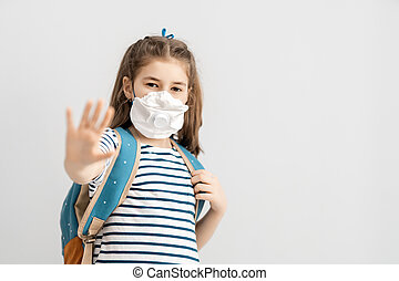 Child is wearing facemask during coronavirus and flu ...