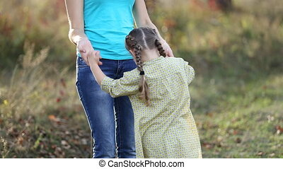 child jumping holding hands