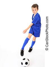 Child kicking ball - Child kicking or manoeuvring a soccer...