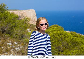 child kid girl in Mediterranean sea with sailor stripes