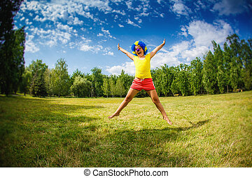child kid girl with party clown blue wig funny happy open arms expression and garlands is jumping in the park