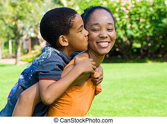 child kiss mother - an african american child giving his...